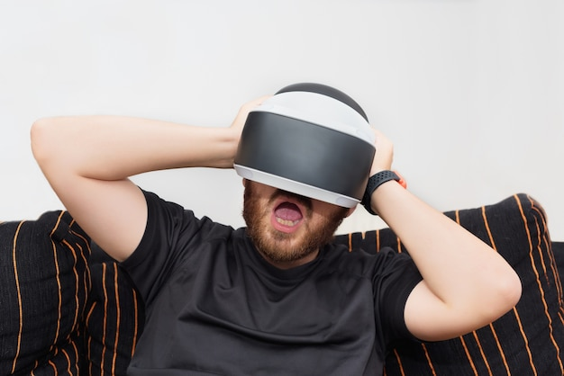 Bearded man wearing virtual reality goggles