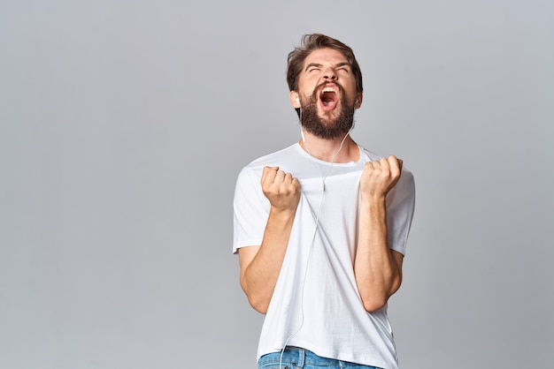 Bearded man in white tshirt gesturing with hands emotion entertainment lifestyle