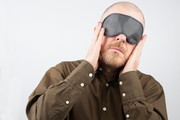 Bearded man with a blindfold for sleeping