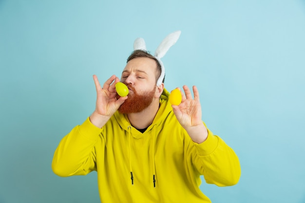 Bearded man with bunny ears for easter