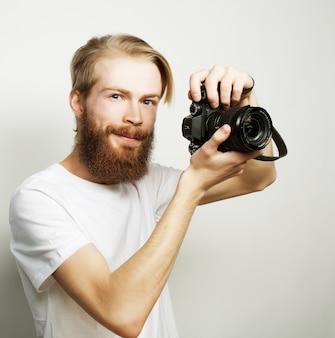 Bearded man with a digital camera