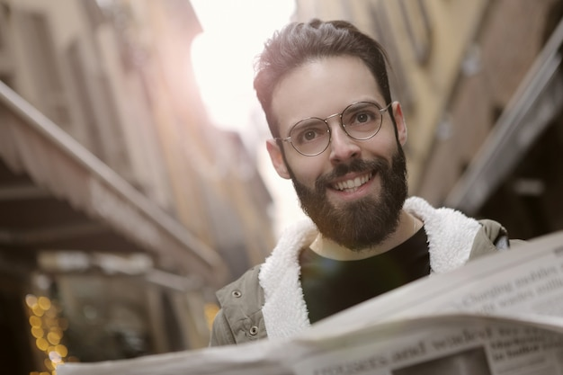 Bearded man with a newspaper