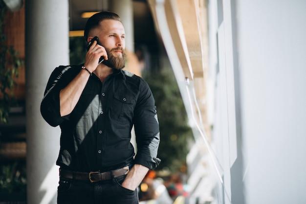 Bearded man with phone