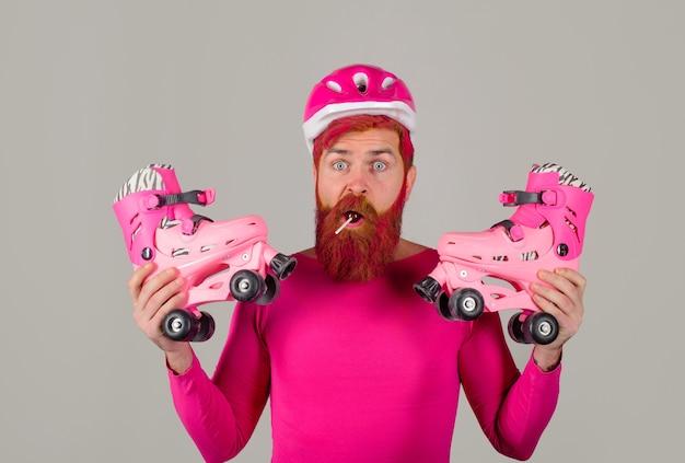 Bearded man with roller skating roller skater rollerblading handsome man with roller skates inline
