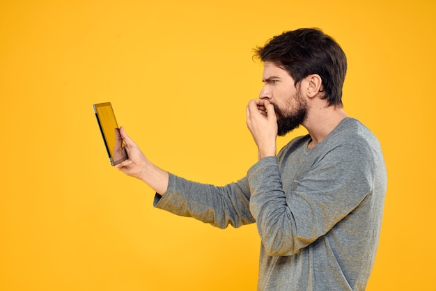 Bearded man with tablet in hands technology work wireless device