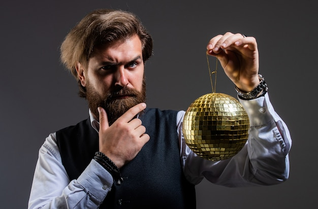Bearded mature man hold golden disco ball, party invitation concept.