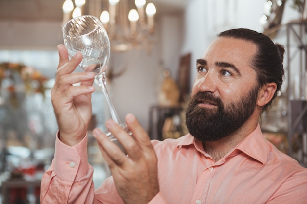 Bearded mature man shopping at home goods store