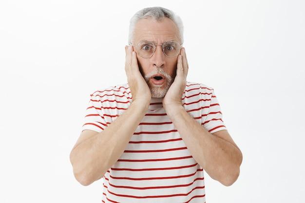 Bearded old man in striped tshirt