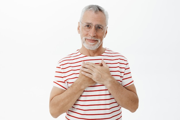 Bearded old man in striped tshirt