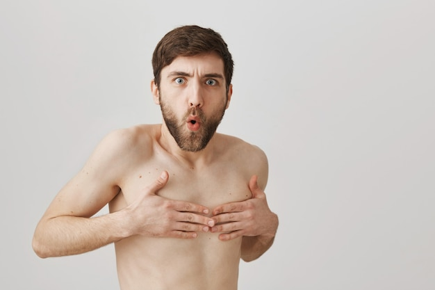 Bearded portrait of a young guy naked