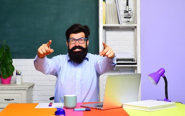 Bearded professor at school lesson in classroom teacher preparing for university exam knowledge day