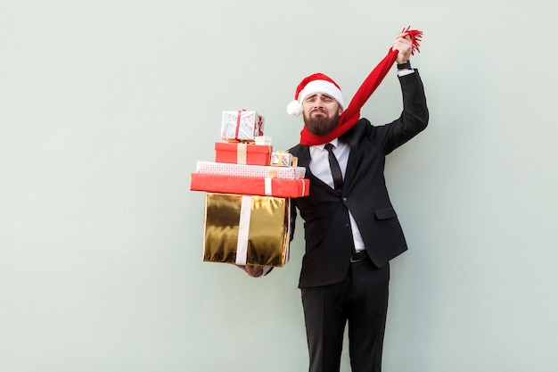 Bearded sadness businessman holding gift boxbuy many gifts and dont have any money
