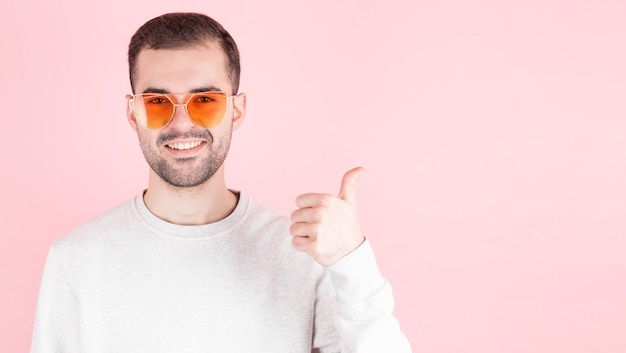 Bearded shows sign super with fingers, man in love wears glasses