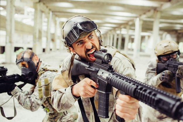 Bearded soldier is screaming and yelling.
