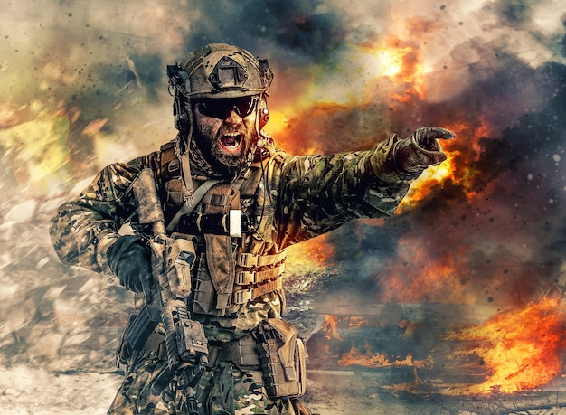 ターゲットを指して攻撃方向を与える特殊部隊のひげを生やした兵士。焼けた廃墟、激しい爆発、銃撃、背景に渦巻く煙