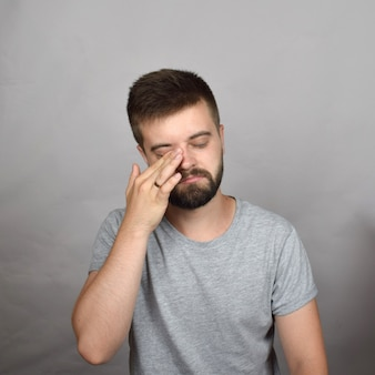 Bearded young man crying