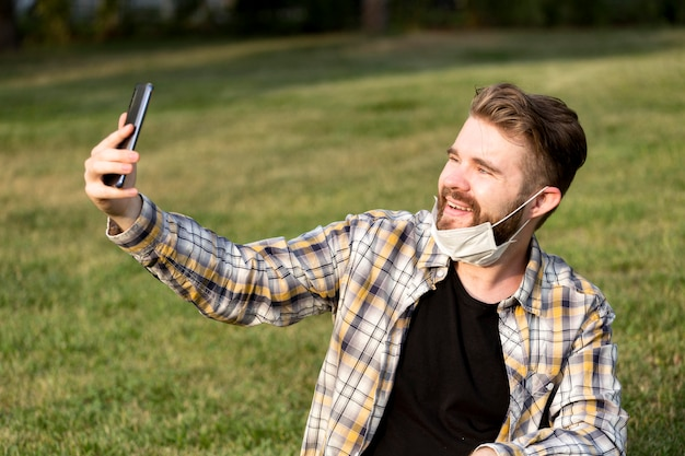 Bearded young man taking a selfie