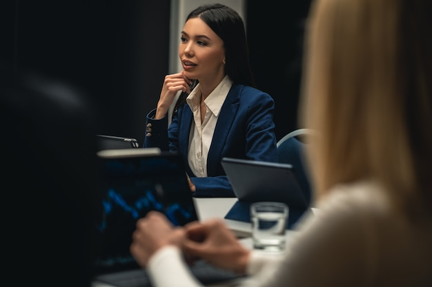 The beatiful asian woman sitting at the table on business meeting