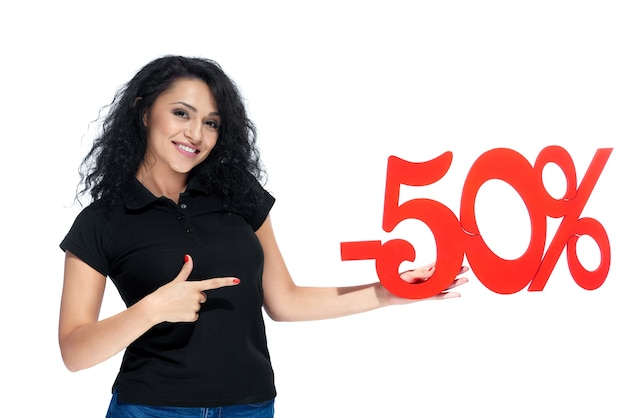 Beatiful curly girl with a red sign -50 sale