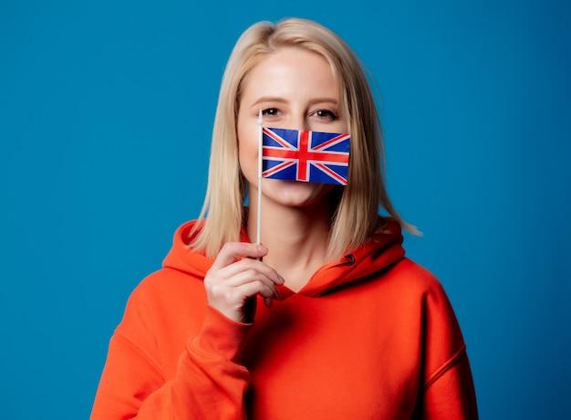 Beatiful girl holds british flag in hand