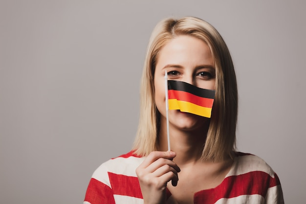 Beatiful girl holds german flag