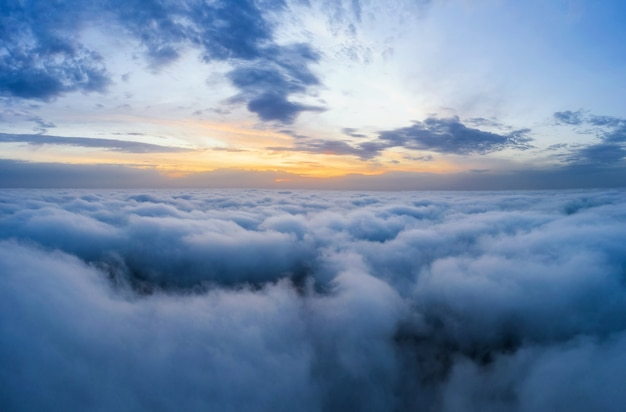 Beatuful dawn sky over clouds high. aerial cloudscape photography.