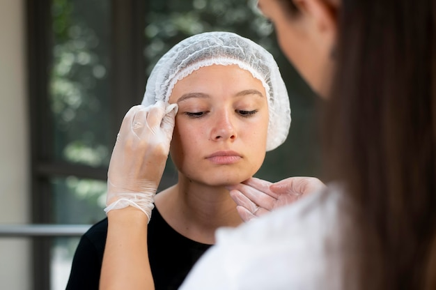 Beautician doing a microblading procedure on a woman