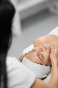 Beautician doing special procedure for improvements skin