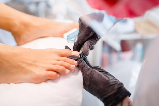 Beautician salon, pedicure, clean procedure.