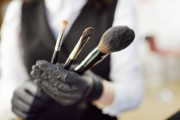 Beautician show brushes for make up and prepares their for use.