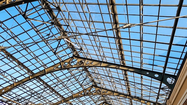 Beautiful abstract image of long glass roof at old railway station. vintage architecture