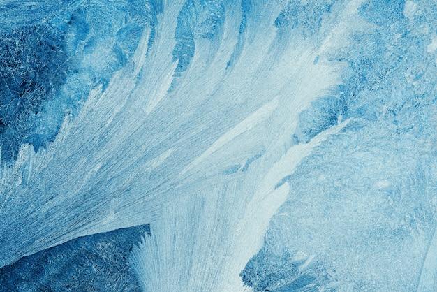 紙のデザインの明るい背景に青い冷ややかなパターンと美しい抽象的なパターン。雪の冬のパターン。