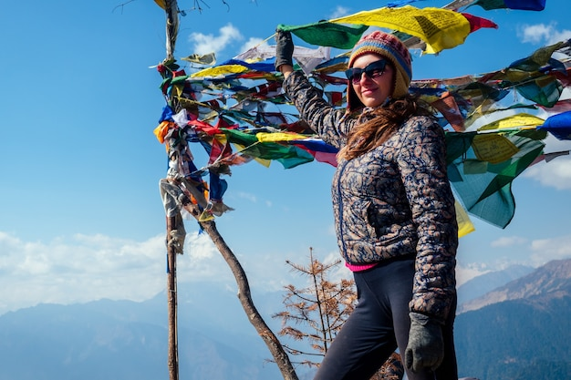 Beautiful and active woman rests in trekking in the mountains. the concept of active recreation and tourism in the mountains. trekking in nepal himalayas