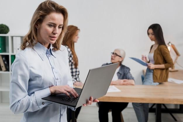 Beautiful adult woman browsing a laptop