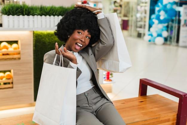Beautiful adult woman happy shopping