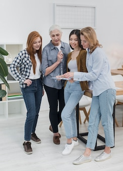 Beautiful adult women planning together