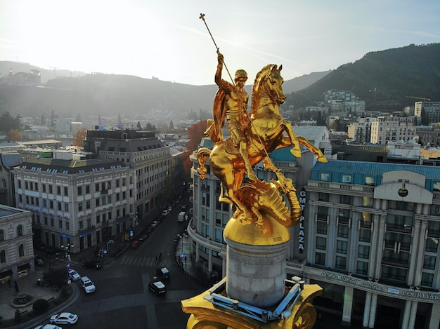 Beautiful aerial drone photography. country georgia from above. capital tbilisi. liberty square and close up portrait of  saint george golden monument.