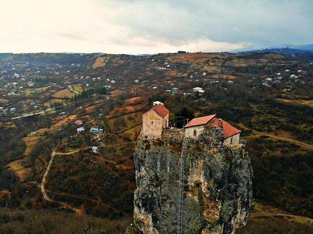 Beautiful aerial drone photography. country georgia from above. mountain monastery and church of katskhi, chiatura region. sunset aerial view