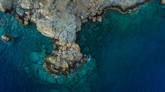 Beautiful aerial drone shot of the sea with rock formations on the shore