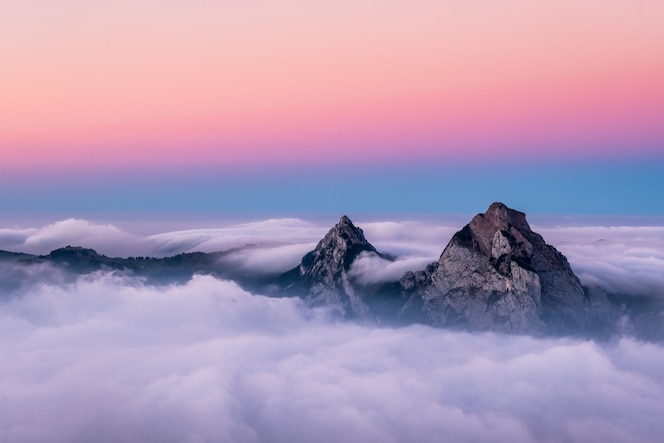 Beautiful aerial shot of fronalpstock mountains in switzerland under the beautiful pink and blue sky