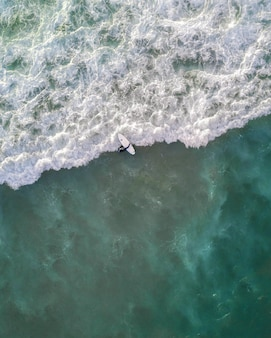 Beautiful aerial shot of ocean waves right from above in bird's eye view - perfect wallpaper