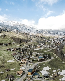 Beautiful aerial shot of a small suburban town in the snowy mountains