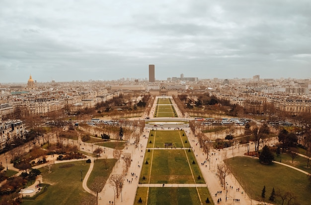 Beautiful aerial shot of tour eiffel gardens under the storm clouds
