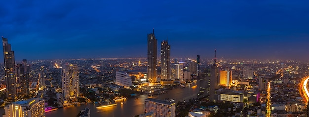 Beautiful aerial view panorama day to night time lapse of bangkok the river, thailand