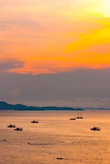Beautiful aerial view of the sea at sunrise twilight time with the shade shadow of shadow boat