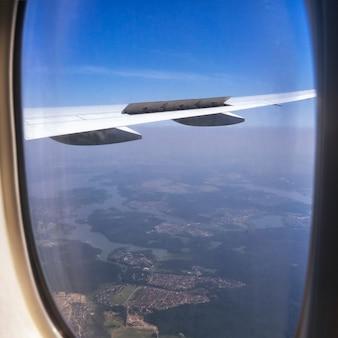 Beautiful aerial view seen through window of flying aeroplane.