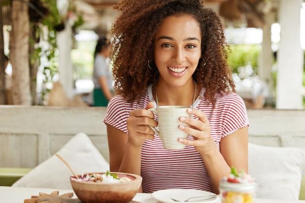 Beautiful african-american woman in cafe