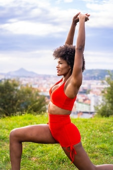 Beautiful african american woman exercising nature