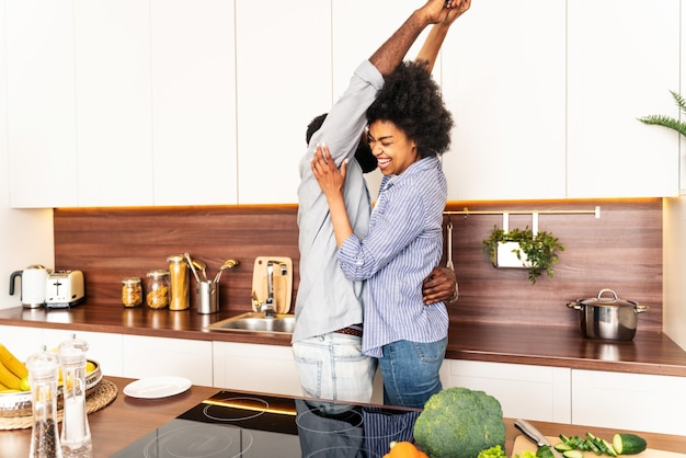 Beautiful afro american couple cooking at home