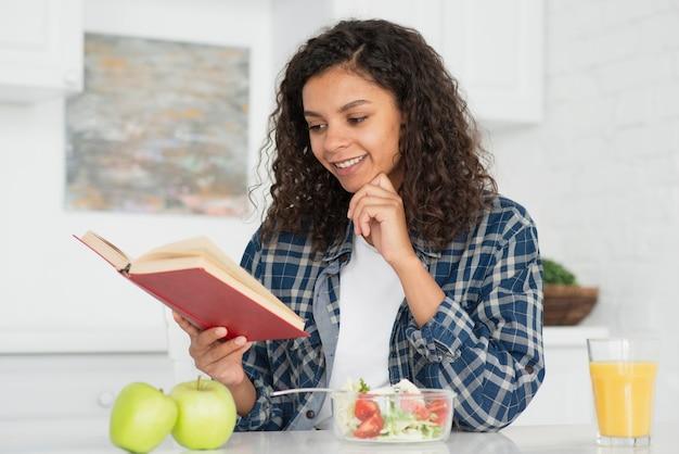 Beautiful afro american woman reading